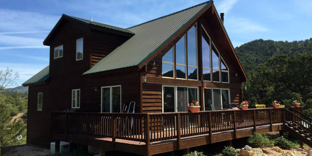 Mountain home with a greenhouse on 35 acres for sale for Mountain home builders colorado